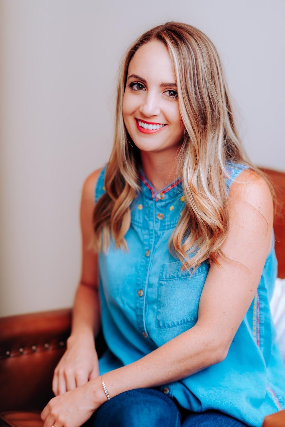 smiling girl in blue sleeveless dress