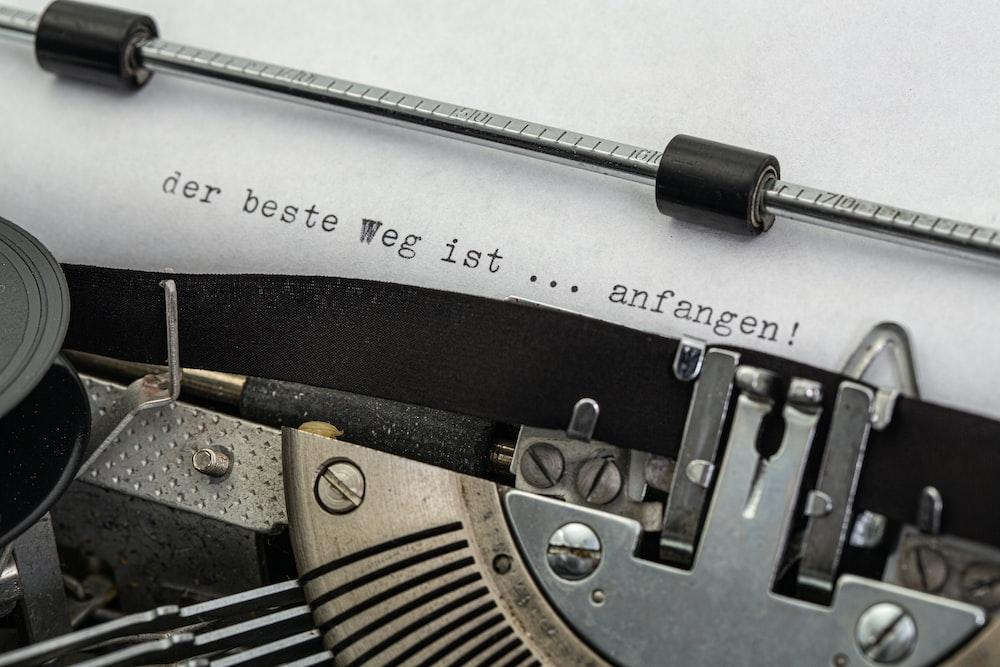 black and gray typewriter on white printer paper