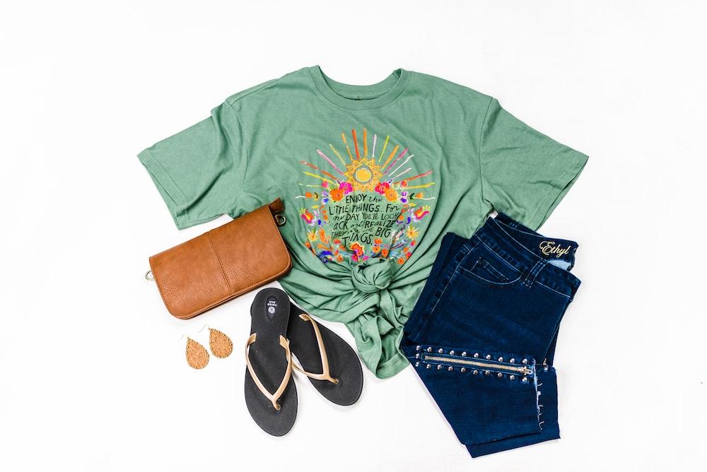 green crew neck t-shirt and blue denim shorts