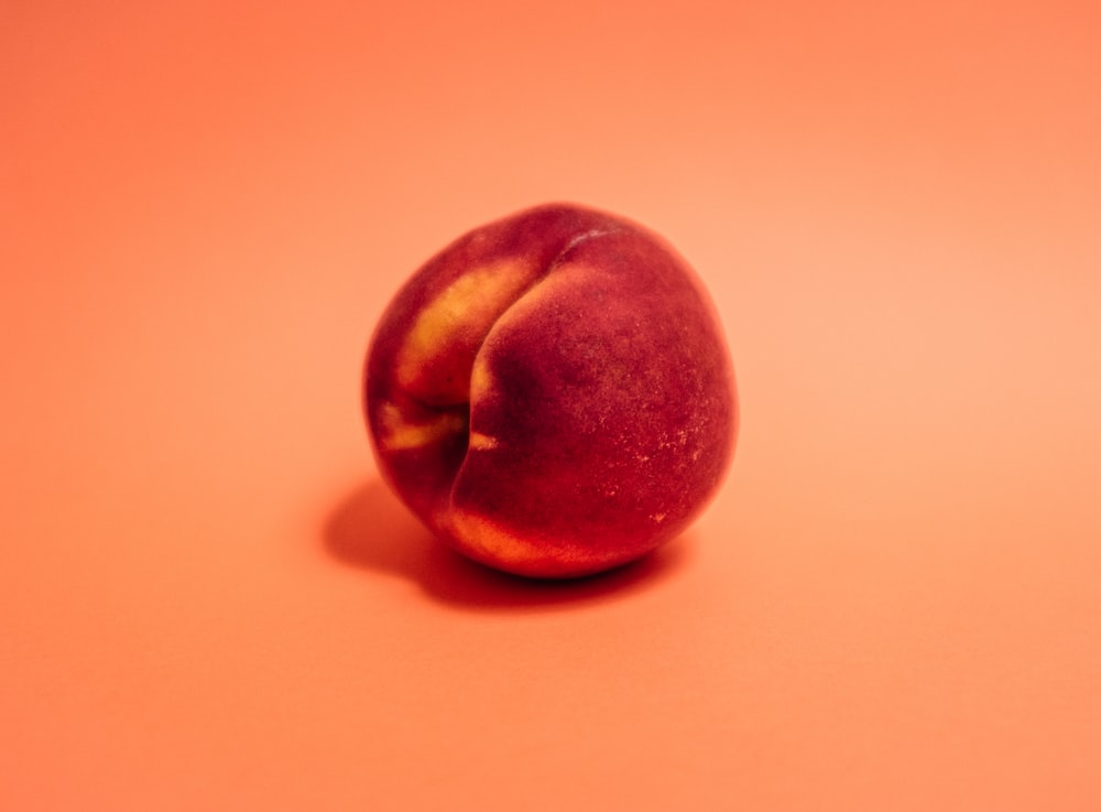 red apple on white table