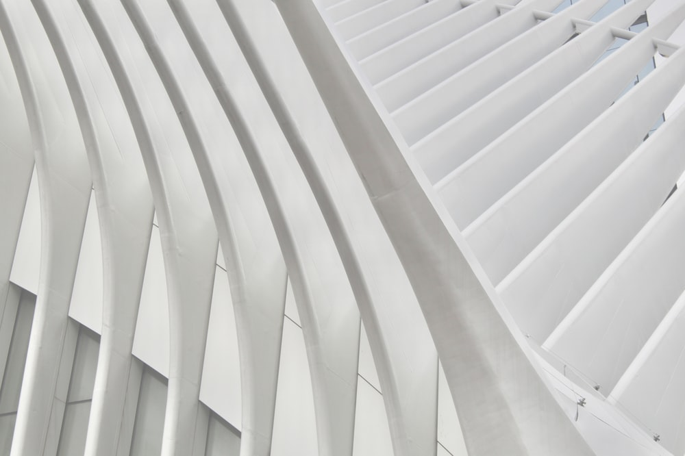 white concrete spiral stairs during daytime