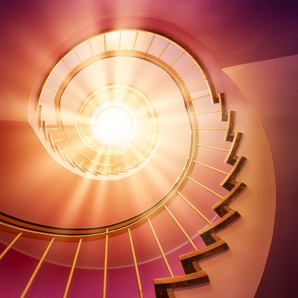 brown spiral staircase with purple lights