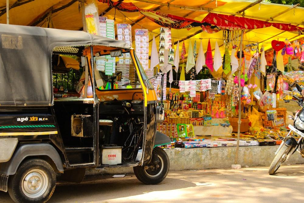 black auto rickshaw on road during daytime