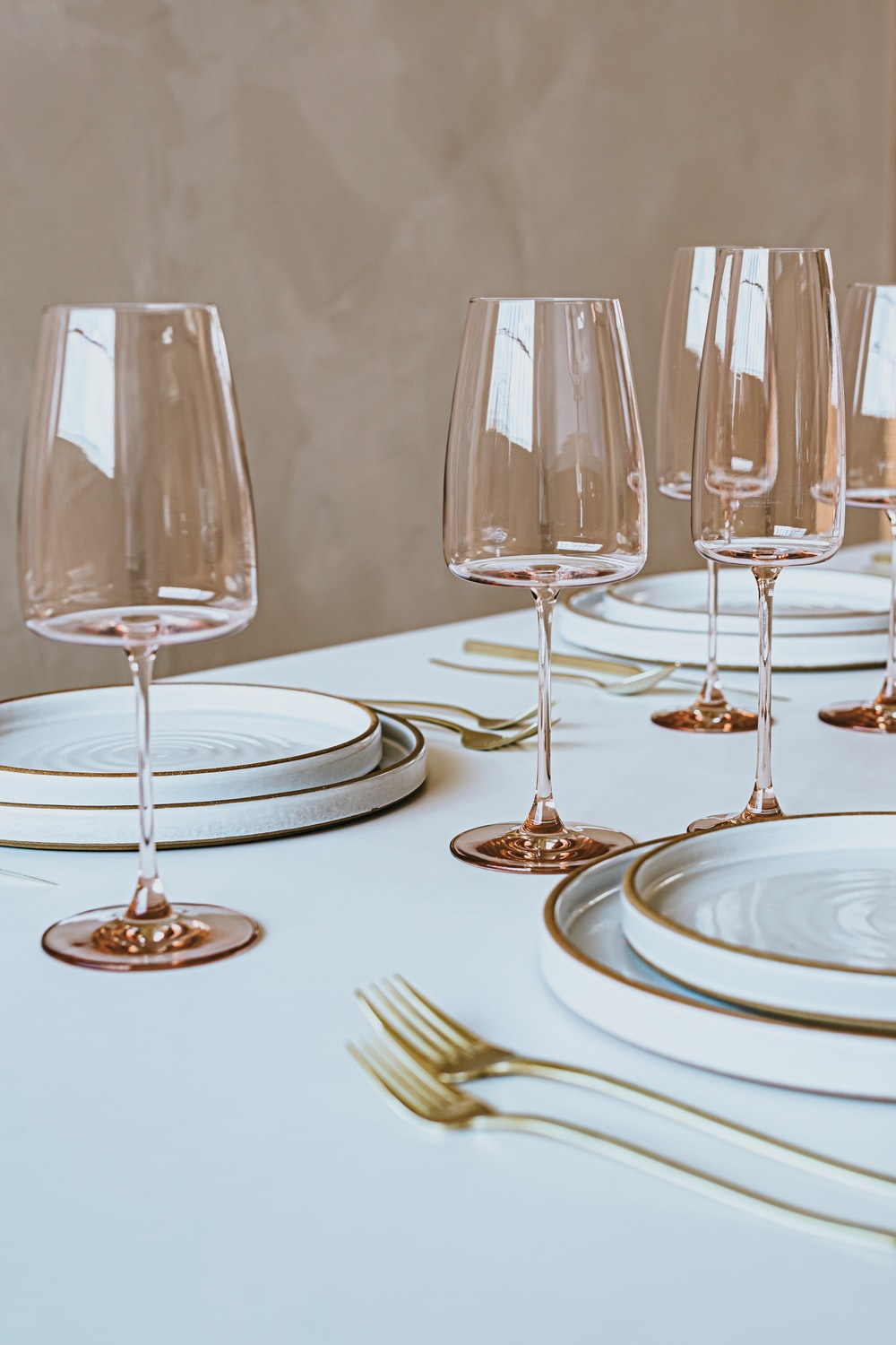clear wine glasses on white ceramic plate