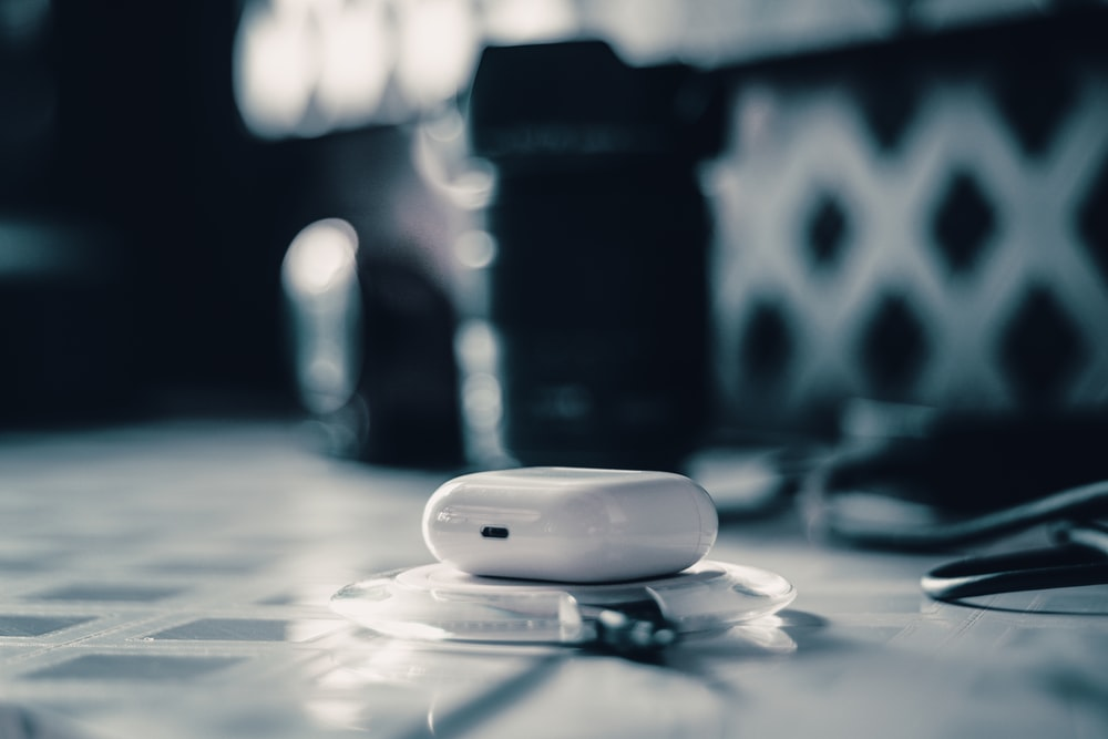 white oval medication pill on white and gray surface