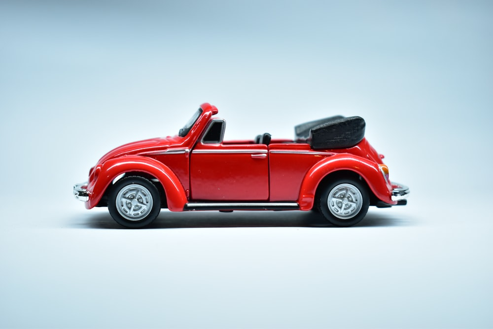 red convertible coupe on white background