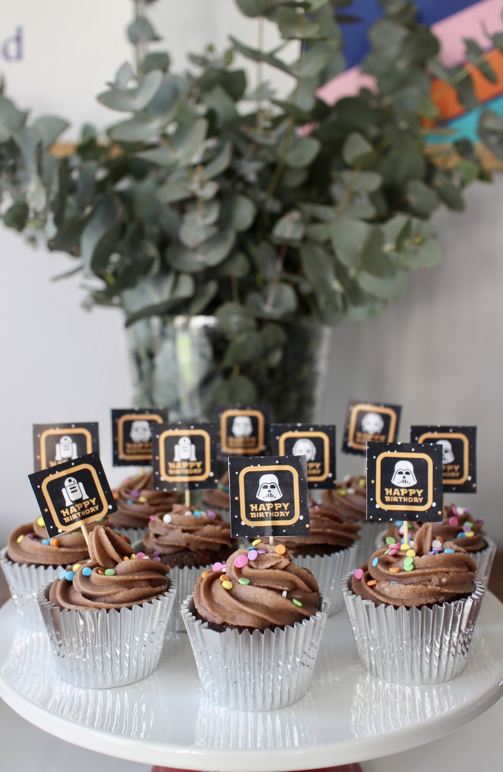 brown and white cupcakes on white wooden table