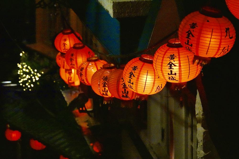 orange paper lantern on blue concrete wall