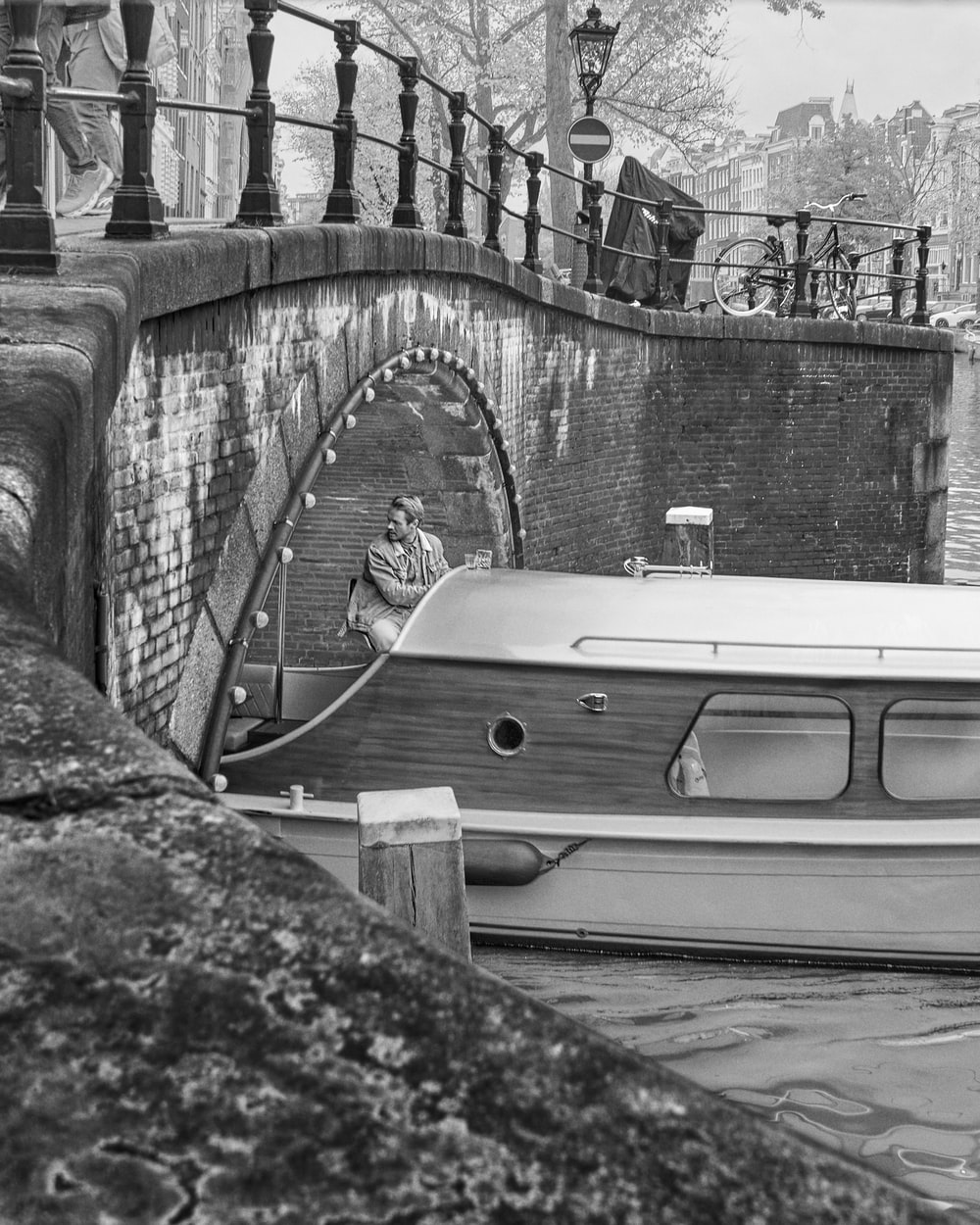 grayscale photo of a boat on a dock