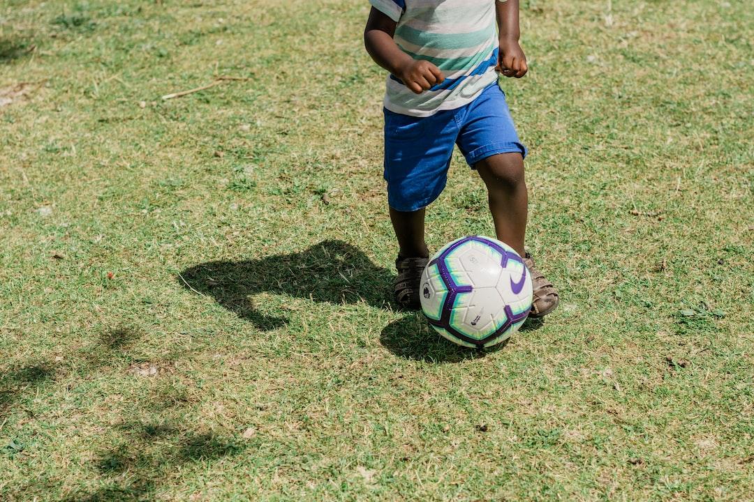 toddler playing football