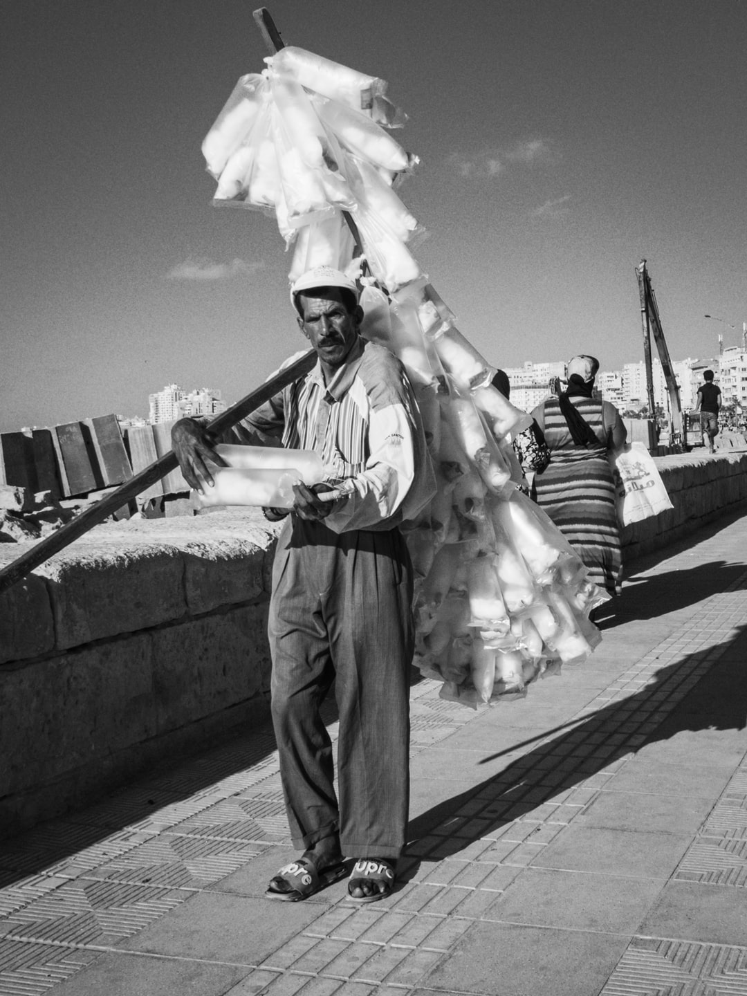 a cotton candy seller at the corniche in alexandria; BW, black and white