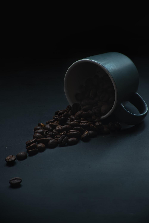 white ceramic mug on black table