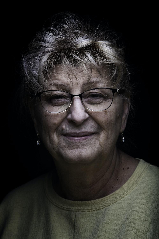 woman in green crew neck shirt wearing eyeglasses