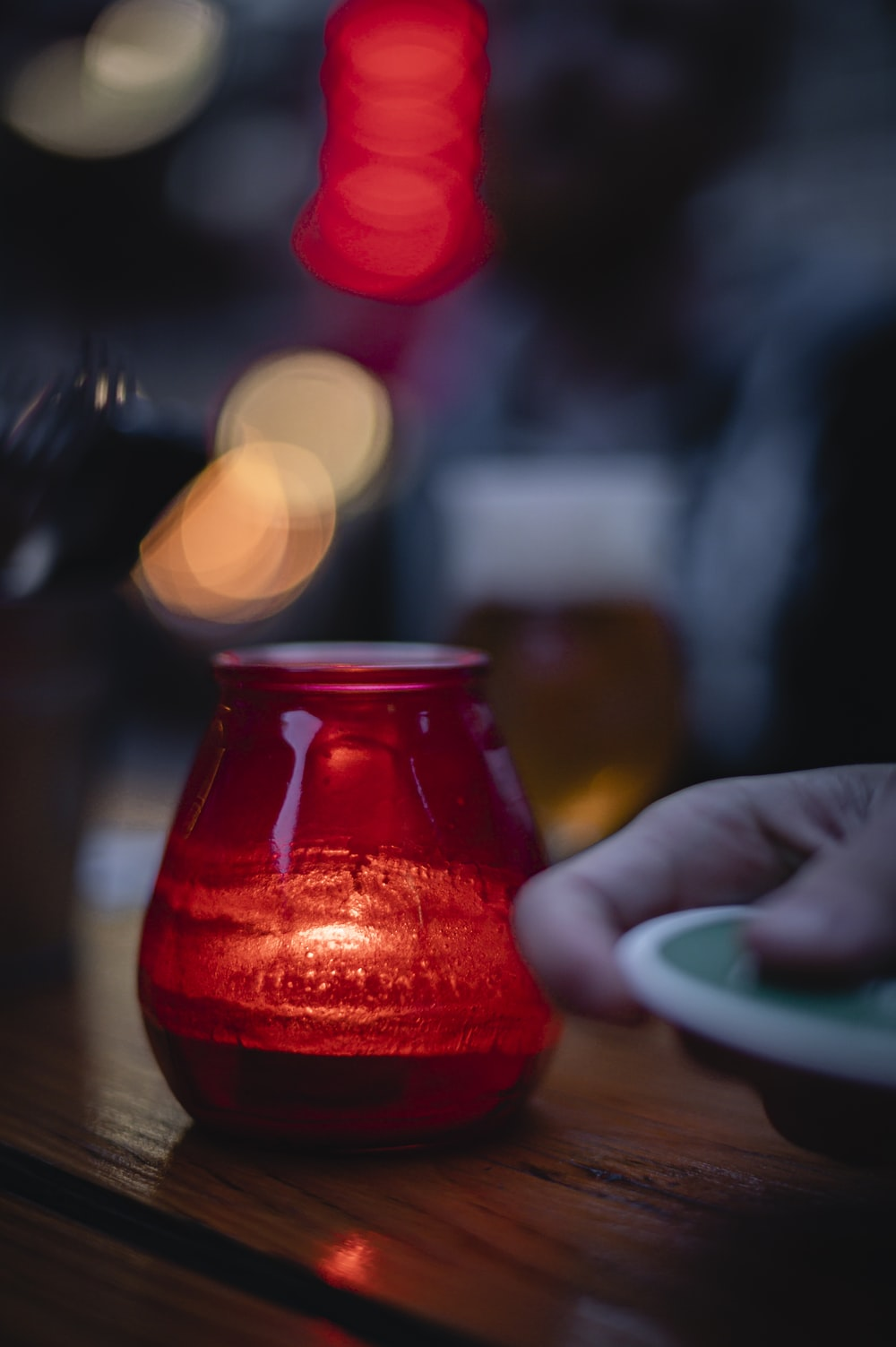 red glass jar with red liquid