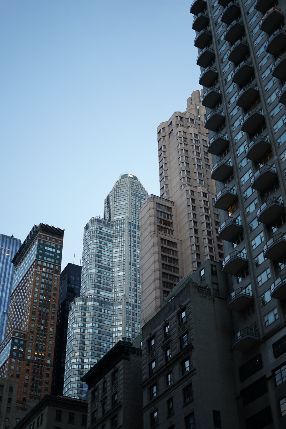 high rise buildings under blue sky during daytime