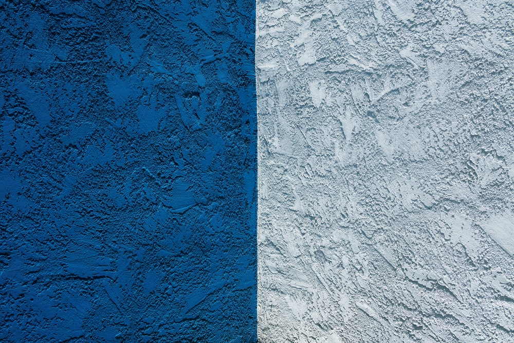 blue concrete wall with white paint