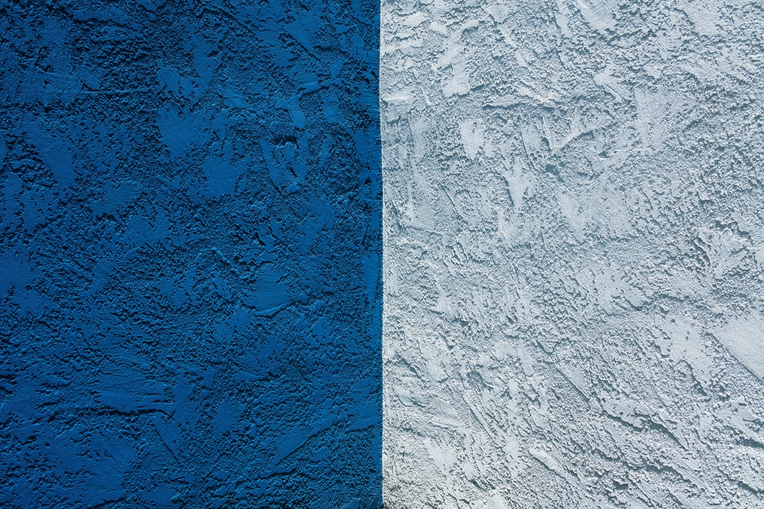 Blue Concrete Wall With White Paint - unsplash