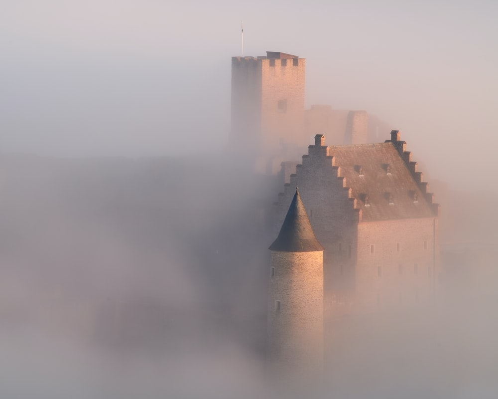 brown castle on foggy weather