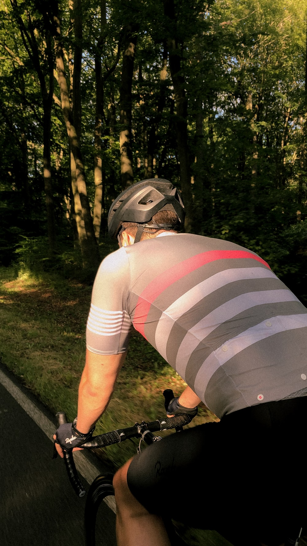 person in white and black stripe shirt wearing helmet