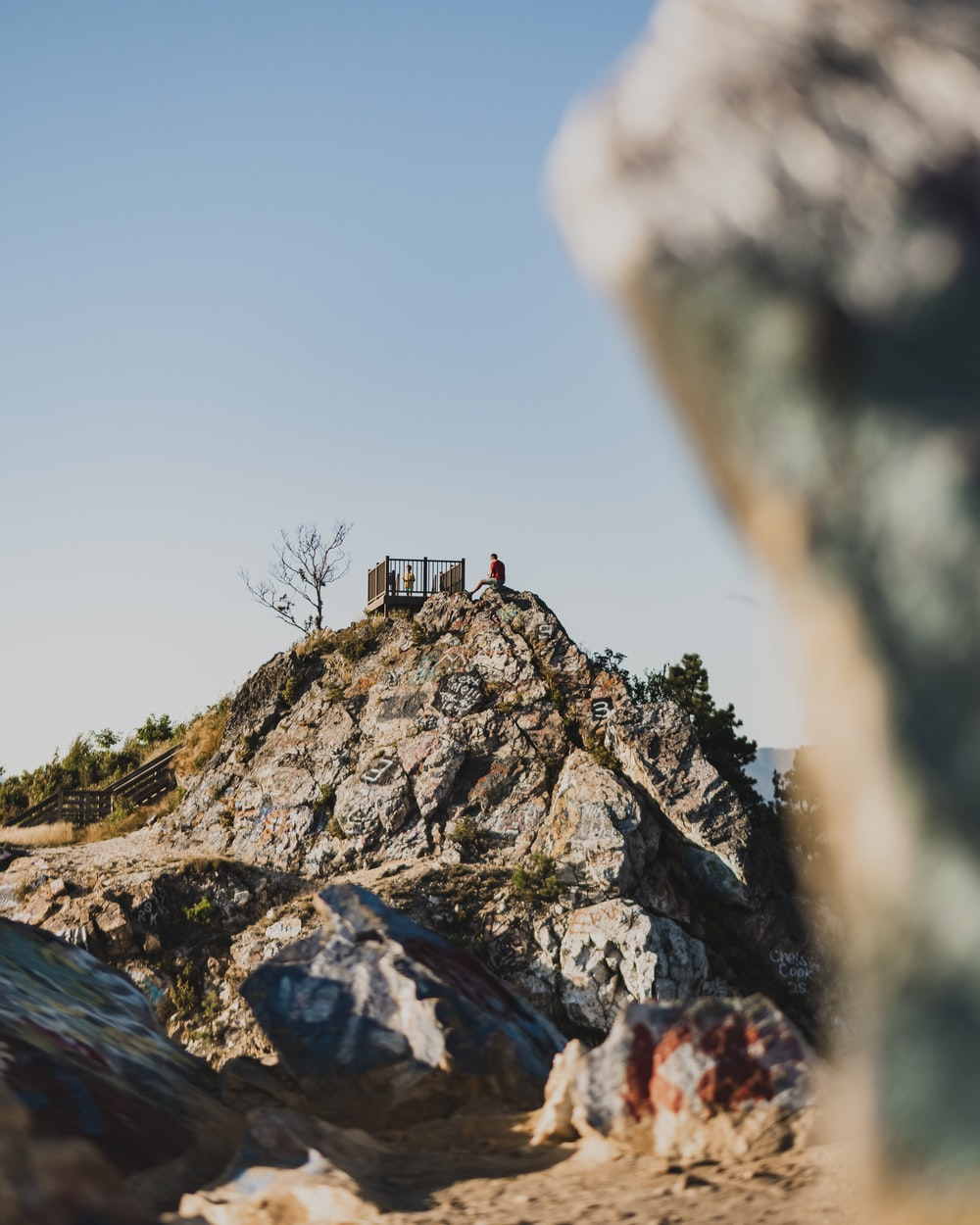 person standing on rock formation during daytime