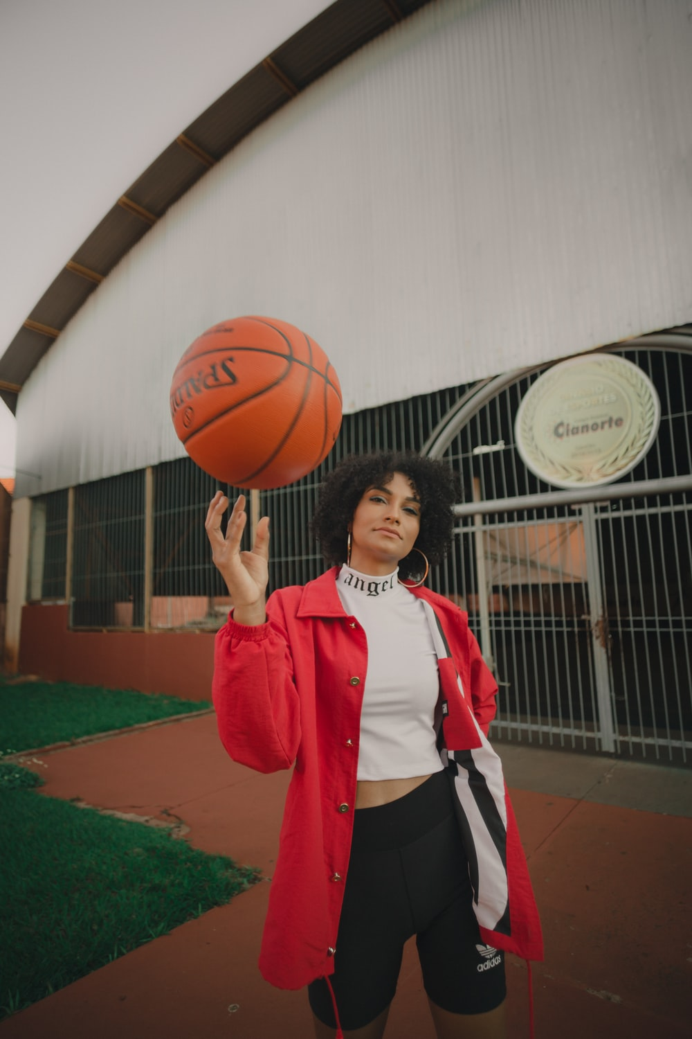 woman in red and white nike jersey holding basketball