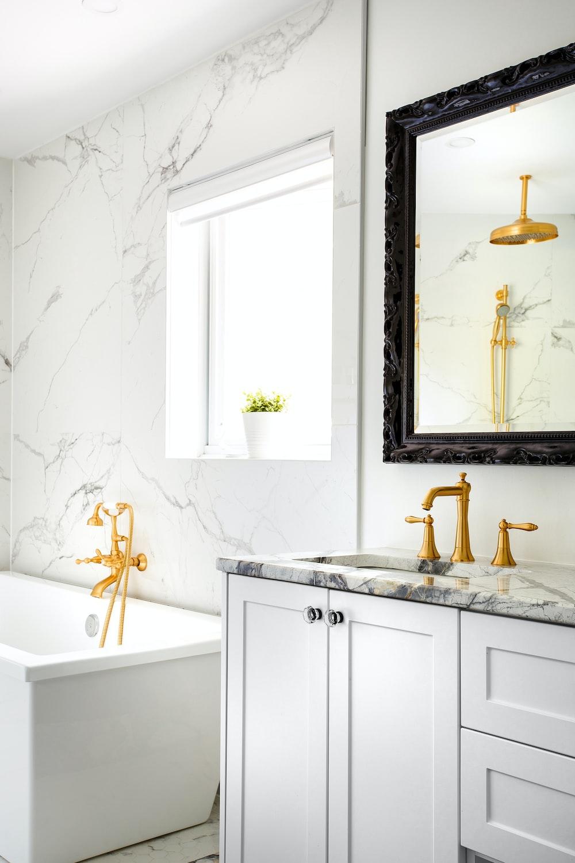 white ceramic bathtub with faucet