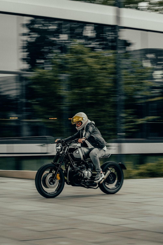 man in white helmet riding black motorcycle