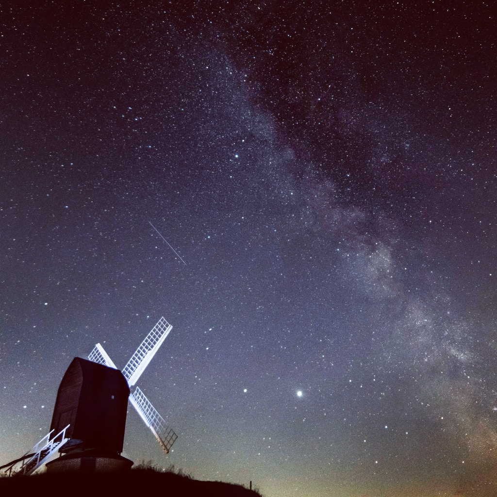 white and black windmill under starry night
