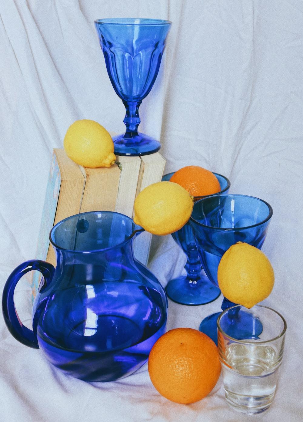 blue glass pitcher with lemon fruits