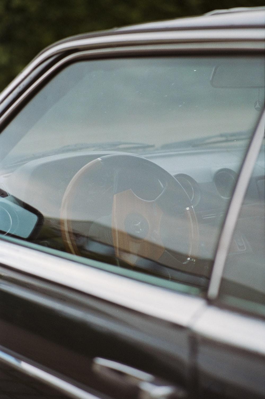 black car side mirror during daytime