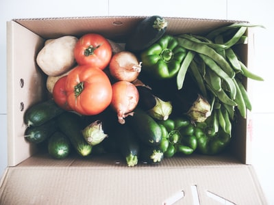 fresh vegetables in cardboard box