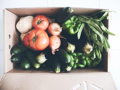 fresh vegetables in cardboard box