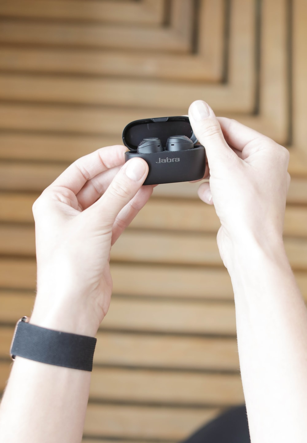person holding black sony camera