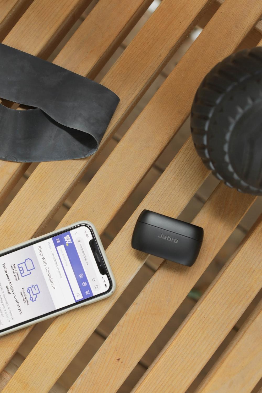 white samsung android smartphone beside black speaker