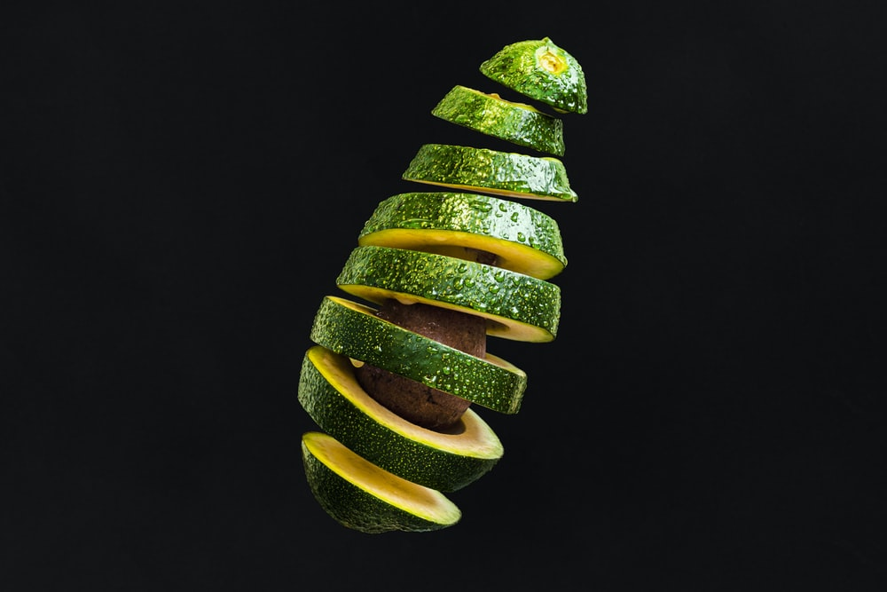 sliced green and yellow fruit