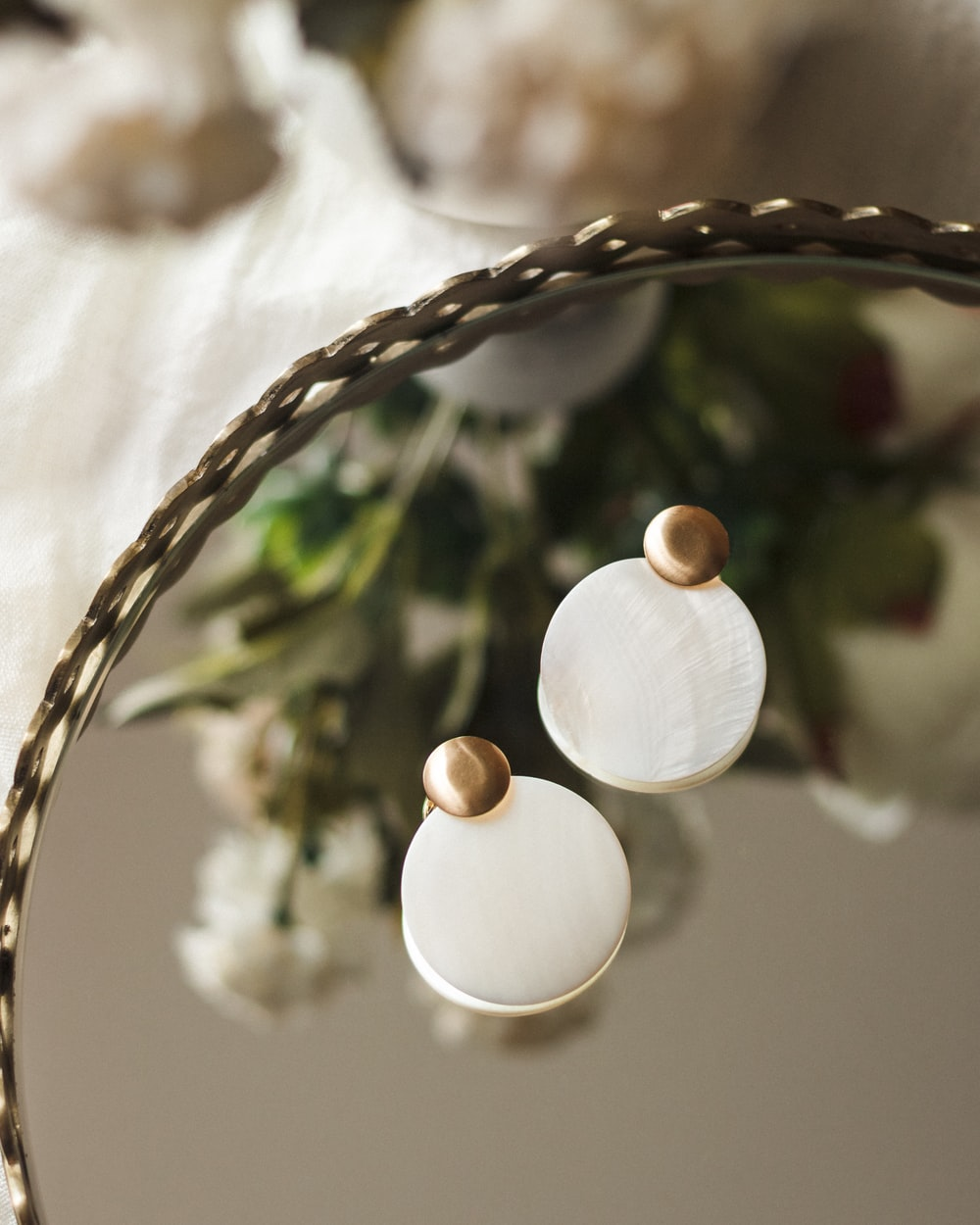 white round ornament on brown woven basket