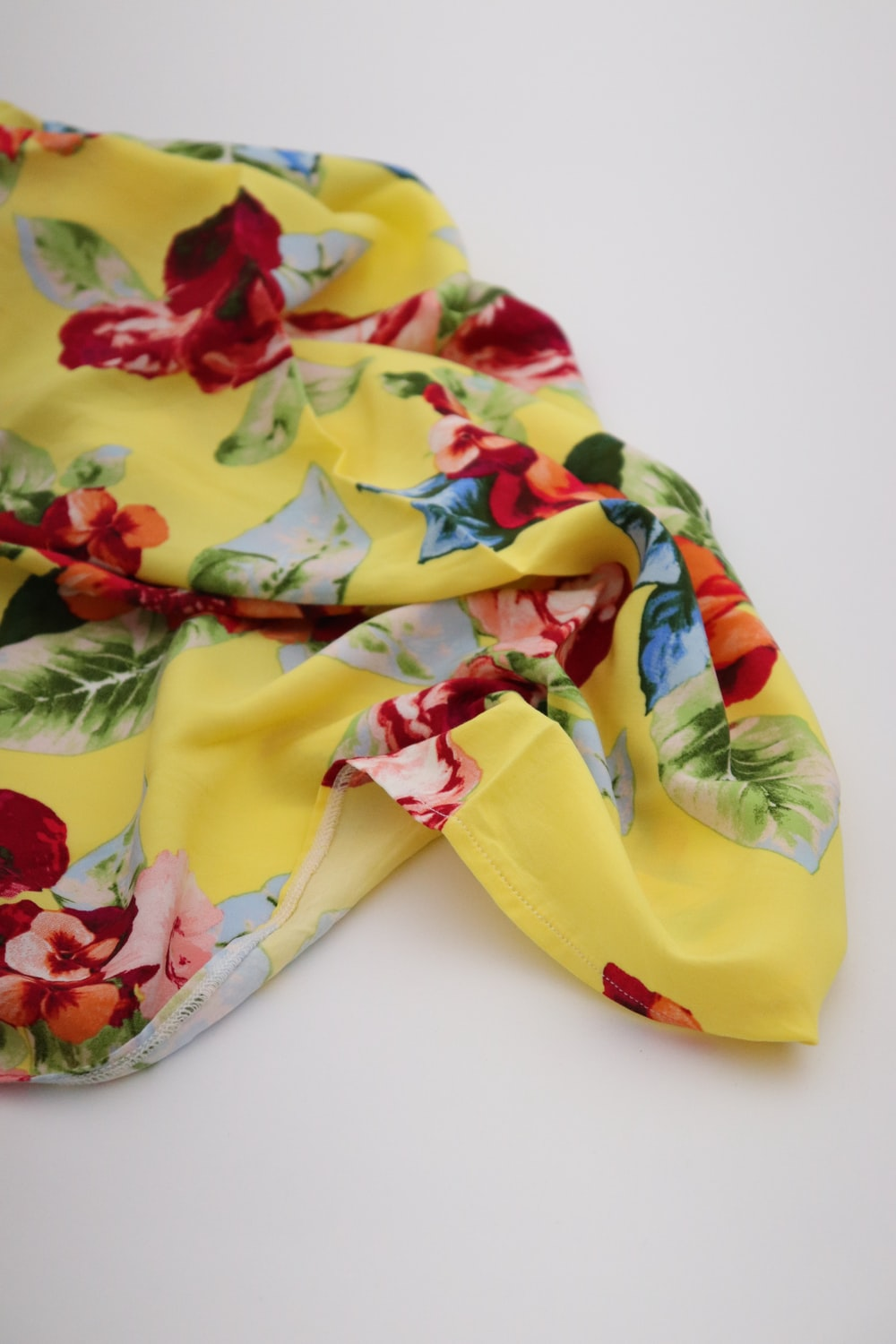 yellow red and green floral textile