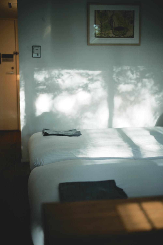 black textile on white bed