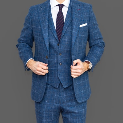 man in blue suit jacket