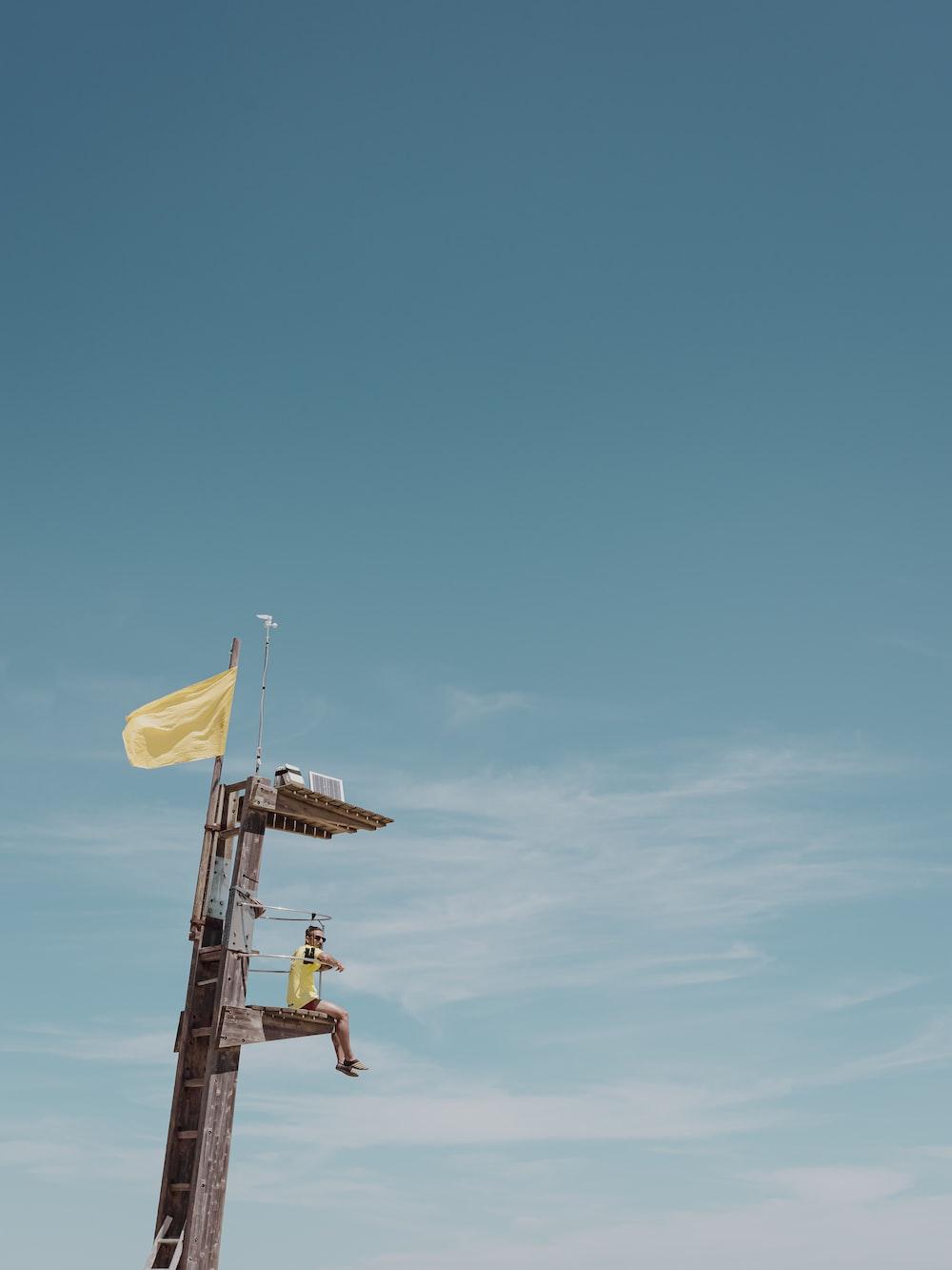 2 men riding on yellow and white plane during daytime
