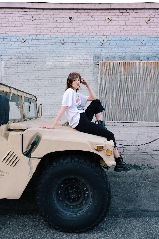 2 women standing beside white car