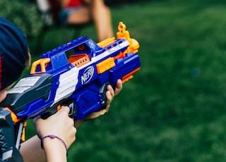 blue and yellow nerf gun