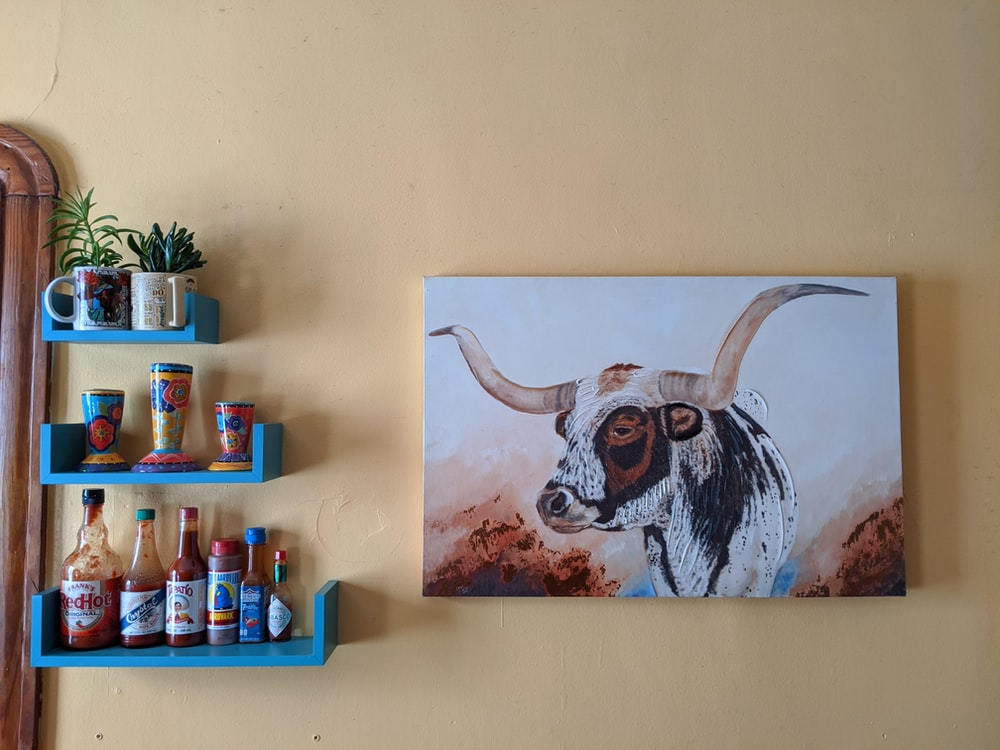 white and blue cow painting