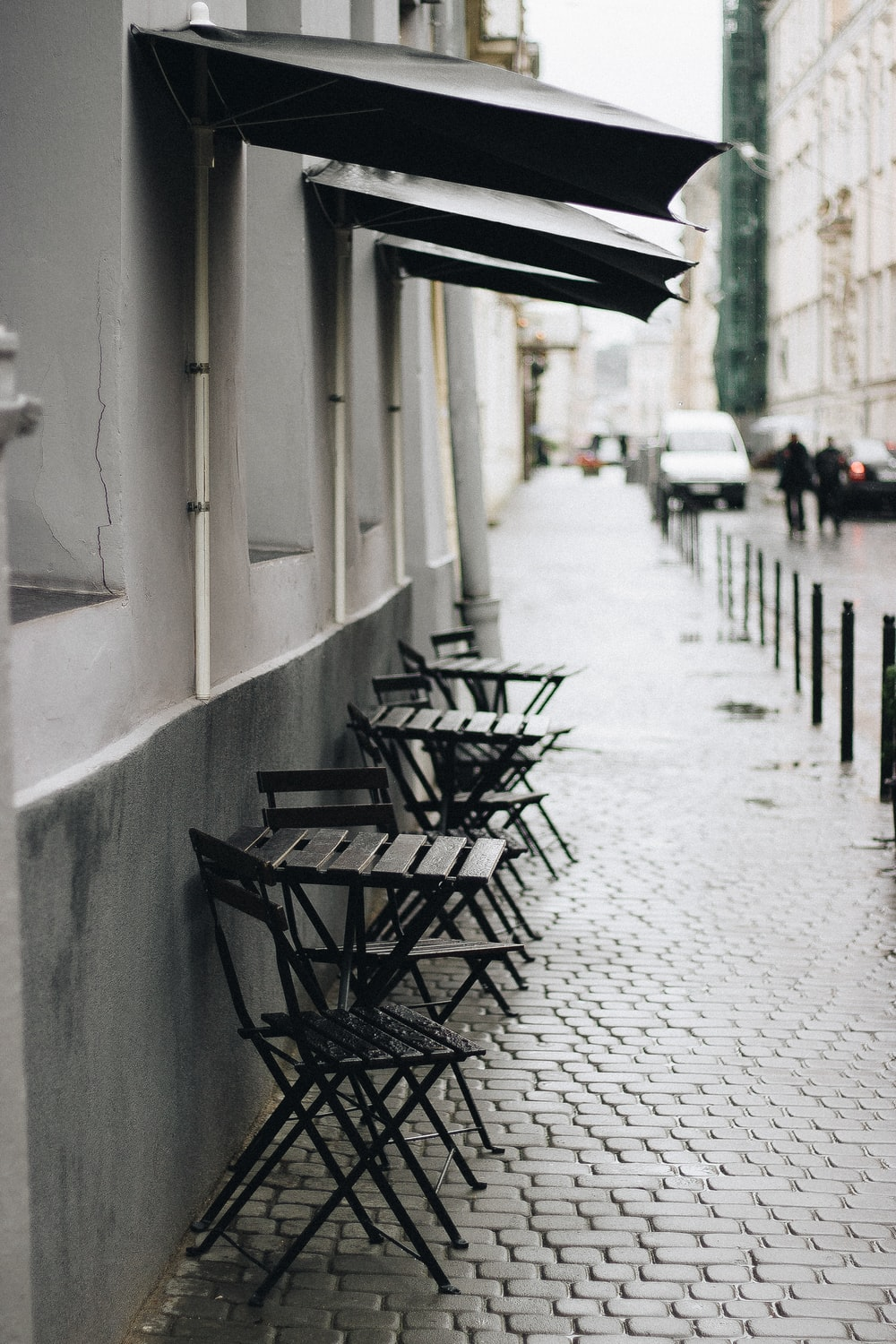 black wooden chairs on white concrete floor