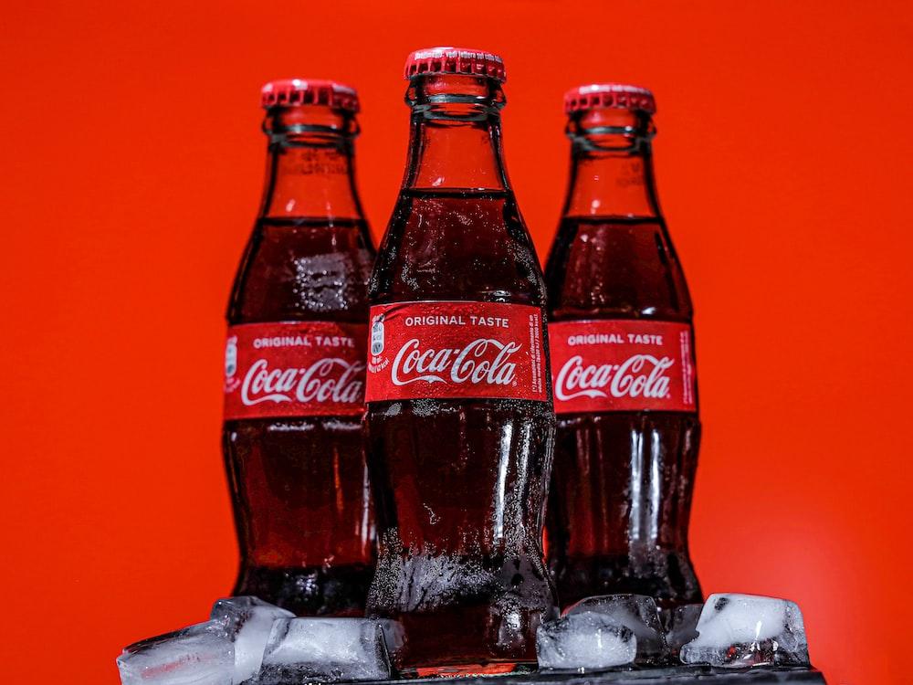 coca cola bottles on black table