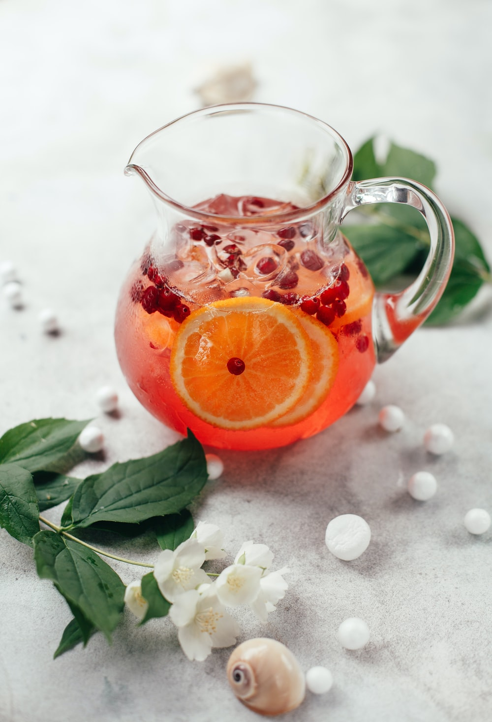 clear glass pitcher with orange fruit juice