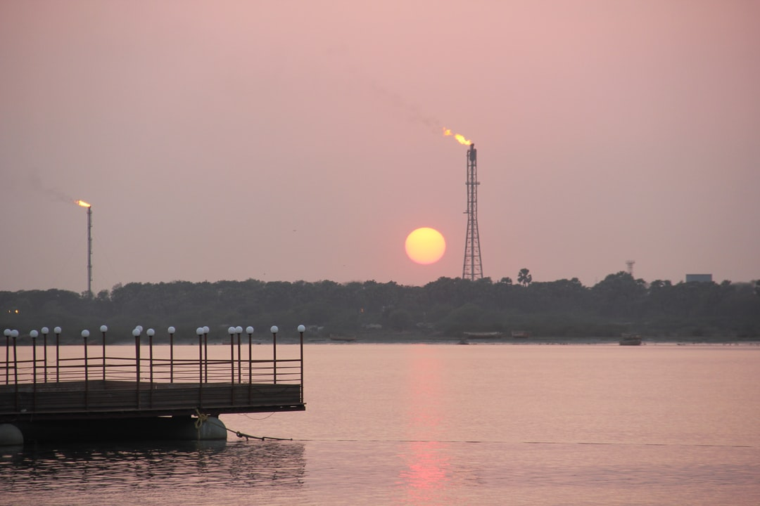 Sunset seen with flam of industry