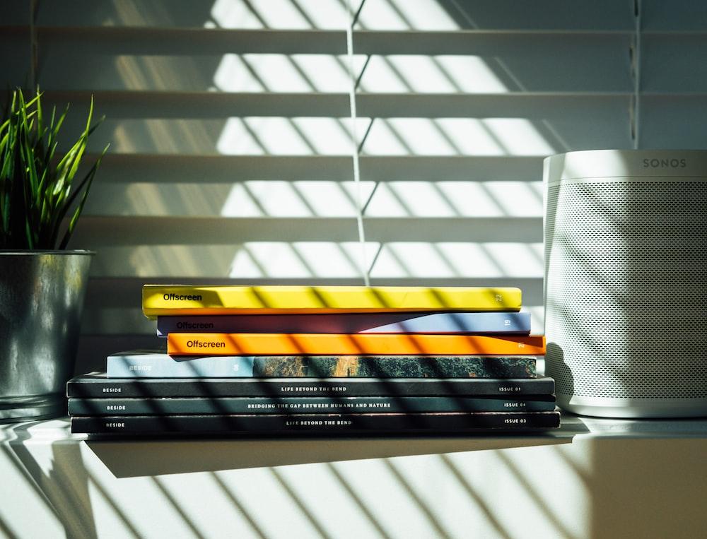 black and yellow books on white shelf