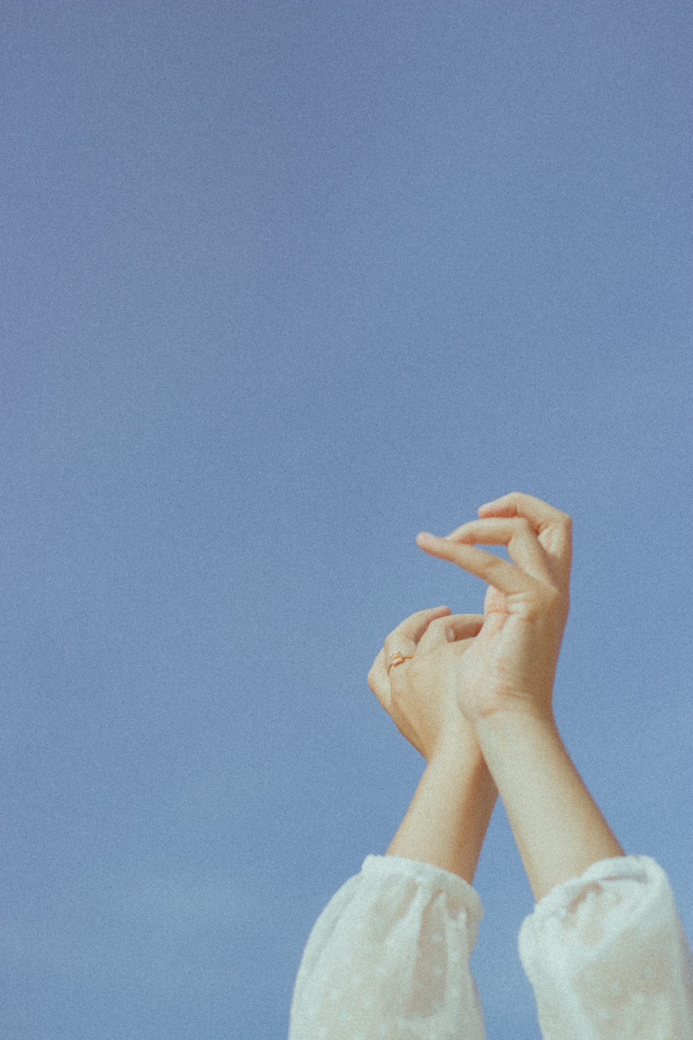 persons hand on blue sky