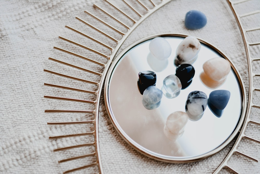 white and blue marble beads on round white ceramic plate